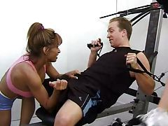 Athletic chicks blow him in the gym tubes