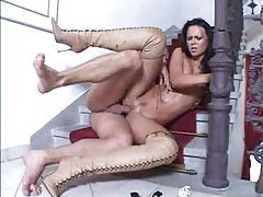 Glamorous girl in sexy boots boned tube