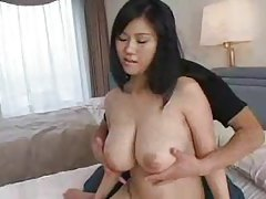 Slowly fondling her huge natural Japanese tits tubes