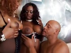 Two sexy sluts worship his big black cock tubes