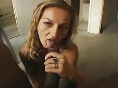 Milf down on her knees blowing big black cock tubes