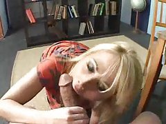 Blonde down on her knees gobbles big cock tubes