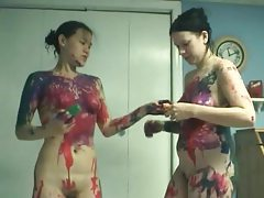 Sexy girls rub paint all over each other tubes