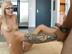 Tattooed nerd in glasses gives footjob tubes
