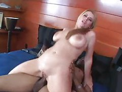 Nice knockers on a blonde having interracial sex tubes