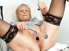 Old lady spreads her legs and plays with her pussy tubes