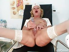 Blonde granny opens her legs and fills her pussy tubes