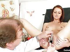 Teenage redhead with speculum in her pussy tubes