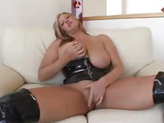 Busty blonde in kinky leather outfit fingers herself tubes
