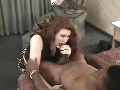 Elegant redhead amateur sucks on thick black dick tubes