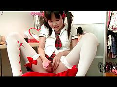 Asian schoolgirl uses pink toy in pussy tubes
