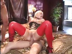 Latex clad slut fucked in DP tubes