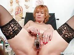 Sexy mature chick in stockings gets an exam tubes