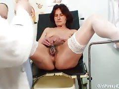 He goes into her pussy with a speculum tubes