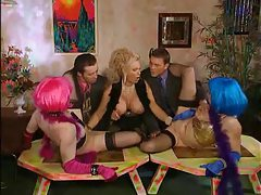 Milf fists two girls as guys watch tubes