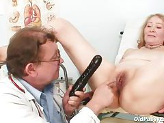 Old lady and her doctor have exam fun tubes