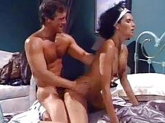 Busty retro babe gets her holes fucked on the bed tubes