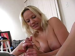 Big titted blonde milf strokes cock with her hands tubes
