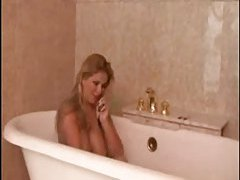 Lusty big tits babe solo in the bathtub tubes