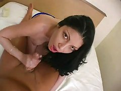 Seductive brunette enjoys smothering cock with her hands tubes