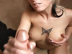 Sultry tattooed blonde hottie milks cock with her hands tubes