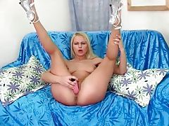 Skinny solo blonde with a pink dildo gets off tubes