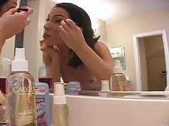 Hot minx fucks herself after putting on makeup tubes