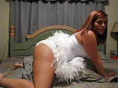 Lustful looking redhead amateur shakes sexy ass tubes