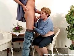 Mature slut in blue blouse sucks cock tubes