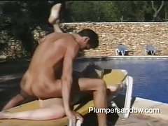 Chunky blonde babe with bouncy tits getting drilled by the pool tubes
