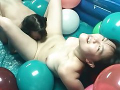 Pigtailed lesbians in pool filled with balloons tubes