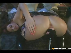 Busty latex clad hottie rides a big dildo tubes