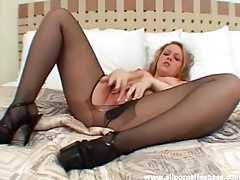 Petite blonde in pantyhose fingering her pussy tubes