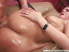 Her oiled body is hot as he pounds her tubes