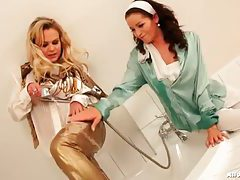 Elegantly clothed ladies enjoying a kinky shower tubes