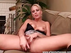 Perky titted blonde hottie using a silver dildo tubes