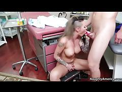Heavily tattooed hottie with massive jugs getting drilled tubes