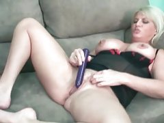 Chubby blonde in lingerie toys her vagina tubes