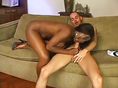 Curvaceous ebony babe fucks her submissive boy with strapon tube