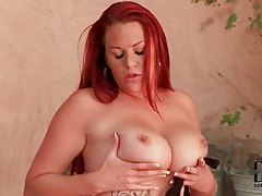Chubby redhead with tattoos using her toys tubes