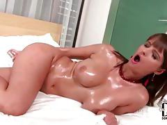 Oiled up brunette hottie with huge jugs slides dildo in her pussy tubes