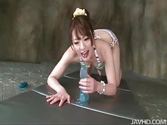 Japanese girl in bikini sits on toy tubes