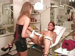 Sensual dominatrix shaves her sex slaves pussy then teases her twat tubes