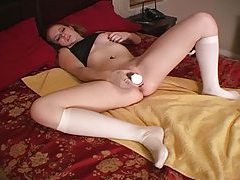 Legs wide open as she toys wet vagina tubes