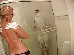 Girls coated in whipped cream take a shower tubes