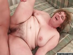 Floppy granny with rolls getting pounded by young guy tubes