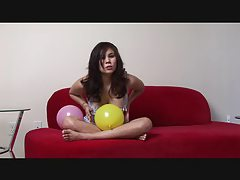 Voluptuous beauty Mia plays with balloons tubes