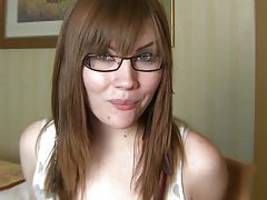 Sexy glasses on a gum chewing teen brunette tubes