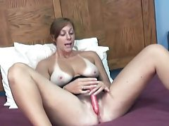 She bares her big tits and toys her hot vagina tubes