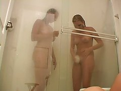 Two hot chicks take a shower and get frisky tubes